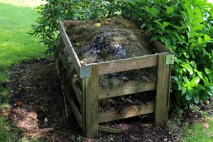 compost pile in wood frame